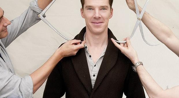 Sherlock actor Benedict Cumberbatch is measured up for his wax figure (Madame Tussauds/PA Wire)