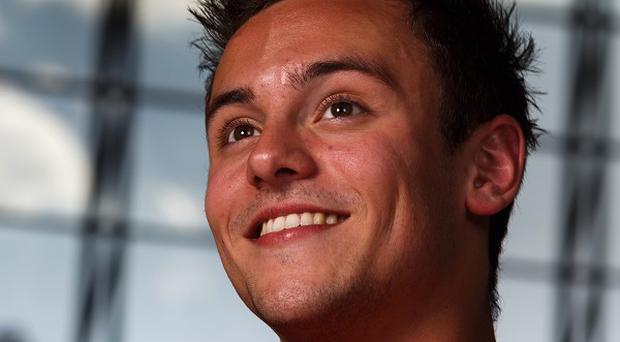 Diver Tom Daley was returning from competing in Shanghai when the plane he was travelling on made an emergency landing