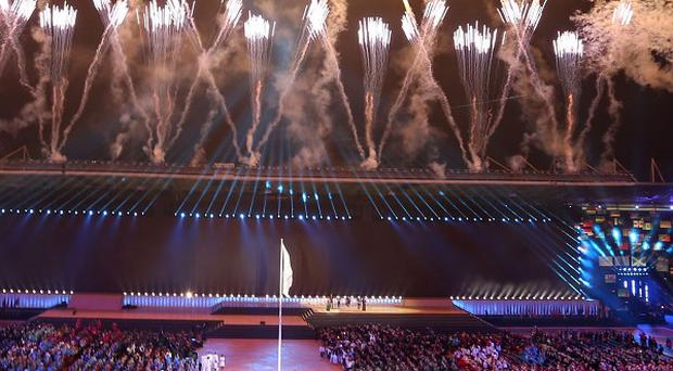 Fireworks explode during the flag raising at the opening ceremony for the Commonwealth Games 2014 in Glasgow (AP)