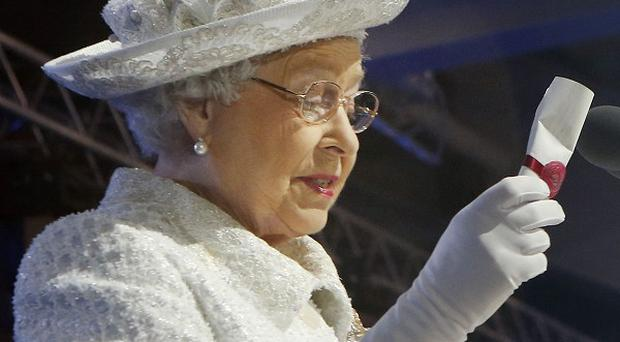 The Queen holds her message during the 2014 Commonwealth Games opening ceremony