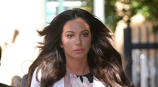 Tulisa Contostavlos denies assaulting a celebrity blogger at a music festival