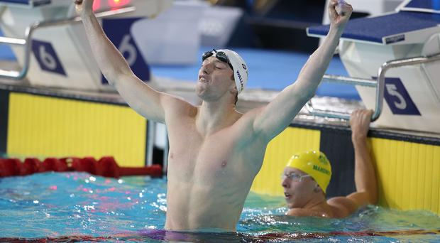 Scotland's Daniel Wallace celebrates winning the Mens 400m Individual Medley