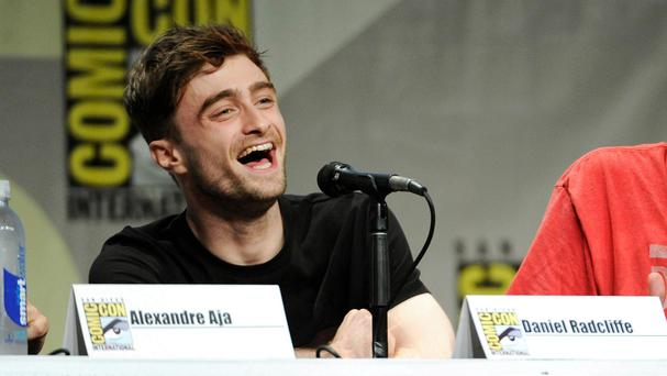 Daniel Radcliffe - without his Spider-Man mask - promoting Horns at Comic-Con International in San Diego (AP)