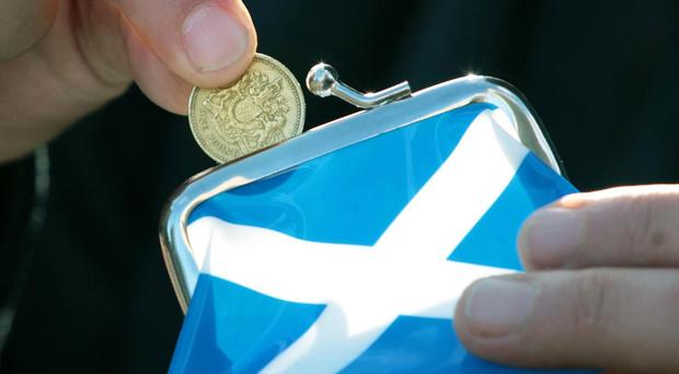 The SNP claims a Yes vote would ensure workers 'earn a fair day's pay for a fair day's work'