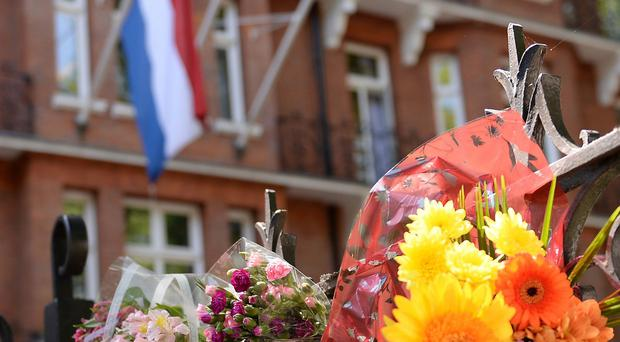 Flowers are laid outside the Dutch Embassy in London to remember the passengers who were killed on Malaysia Airlines flight MH17