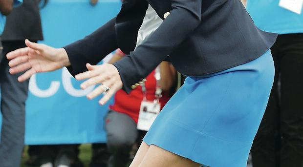 The Duchess of Cambridge gamely leaps the 'Three Tins' at the Unicef event