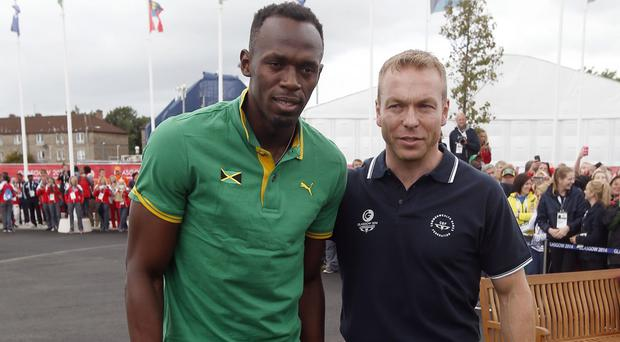 Sir Chris Hoy, right, and Usain Bolt at the Games