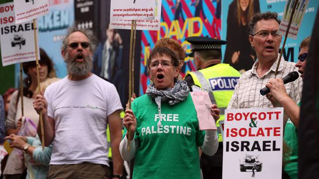 Protesters against military action in Gaza during a demonstration in Bristo Square, Edinburgh