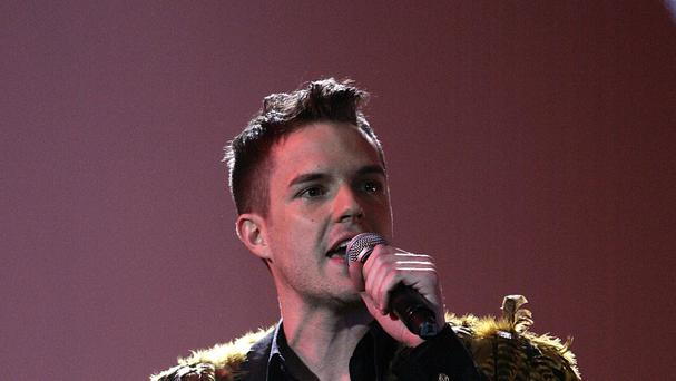 Brandon Flowers has defended his weird lyrics