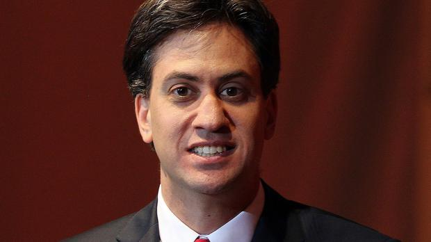 Ed Miliband said a Labour government would cap annual fares on every rail route