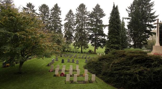 Mrs Jones will attend the special evening ceremony at St Symphorien military cemetery near Mons (pictured)