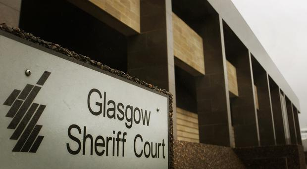 A Commonwealth Games weightlifter has gone on trial at Glasgow Sheriff Court accused of sexual assault