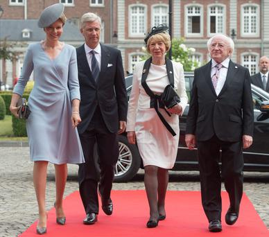 King Philippe of Belgium and Queen Mathilde welcome Irish President Michael Higgins and his wife Sabina to the Saint-Laurent Military Quarters before ceremonies to mark the 100th anniversary of the start of World War One