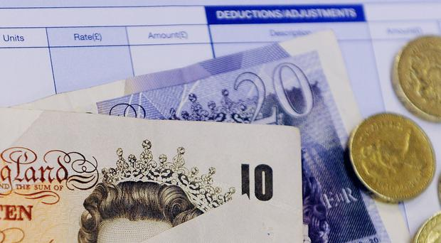 Notes and coins on a payslip. Inflation fell for the sixth month in succession in March paving the way for an end to the prolonged squeeze on wages, official figures showed today.