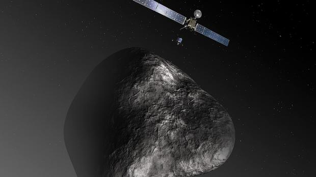 An artist's impression of Rosetta and its lander Philae approaching comet 67P/Churyumov-Gerasimenko (European Space Agency)