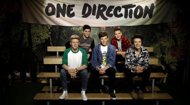The wax figures of One Direction following a makeover at Madame Tussauds