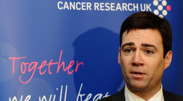 Andy Burnham accused David Cameron of failing in his pledge to cut waiting times