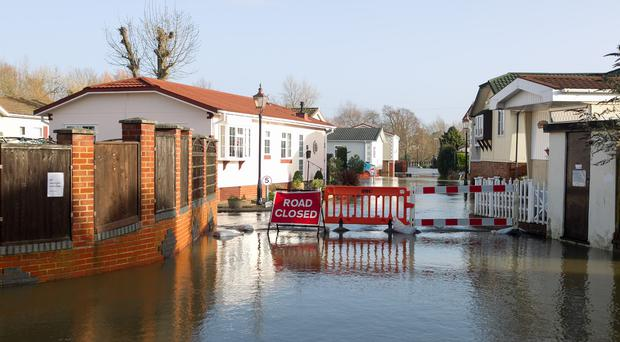 Labour claims the Tories would put 330,000 more properties at risk of flooding over the next 20 years by failing to tackle climate change