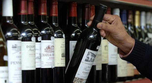 Labels on alcohol products should warn about the harmful effects of drinking, the group said