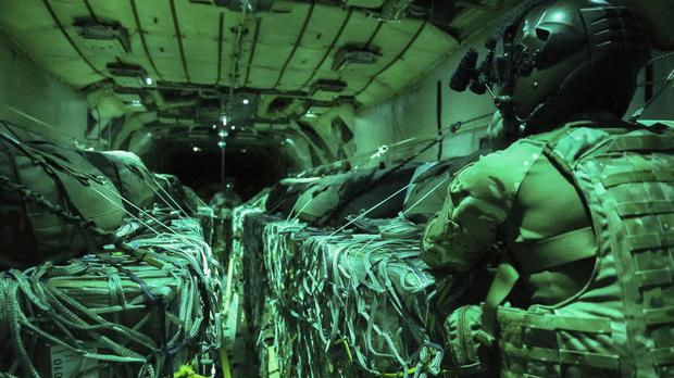 Aircrew on the RAF Hercules delivering emergency aid air drops to people in Northern Iraq. (MoD/PA)
