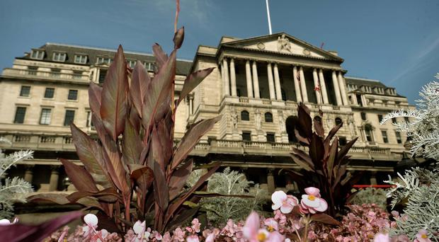 File photo dated 30/07/14 of the Bank of England in London, which will publish its latest outlook for the UK economy today, with its forecasts likely to be seized on for any signs that interest rates might rise by the end of this year.