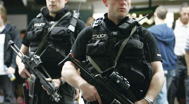 Armed police officers patrol Glasgow Airport – now there are fears number could be cut