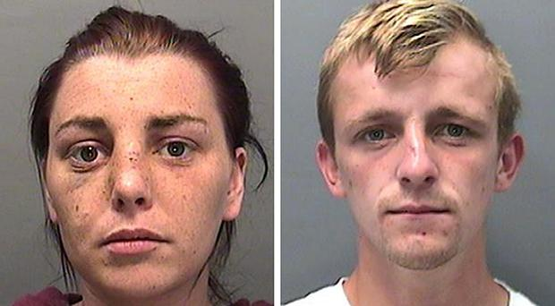 The pair raided an epileptic woman's home while she lay fitting on the ground (South Wales Police/PA)