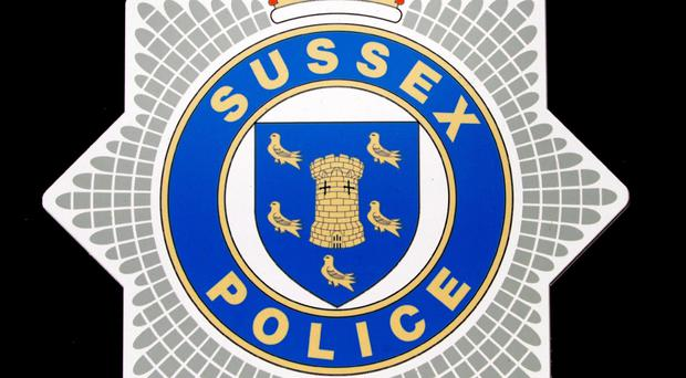 Sussex Police said the woman was taken to hospital suffering from a suspected broken foot and injuries to her face and arm