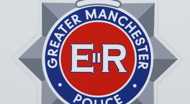 Greater Manchester Police said a woman has been arrested on suspicion of murder