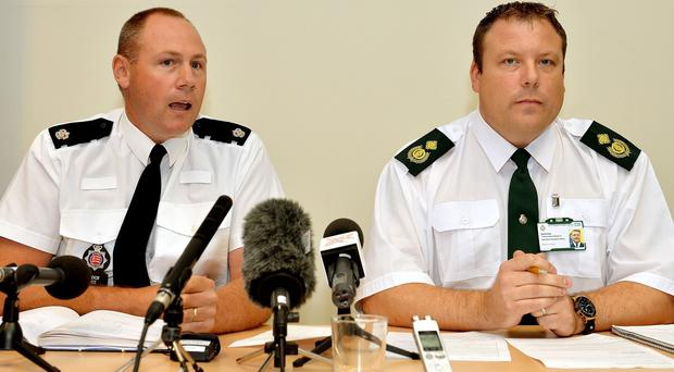 Superintendent Trevor Roe of Essex Police and Daniel Gore (right) of the East of England Ambulance Service, at a press conference near Tilbury Docks