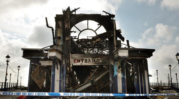 Eastbourne Pier was partially destroyed by fire on July 30