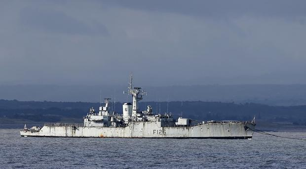 HMS Plymouth is towed away from Liverpool to be scrapped