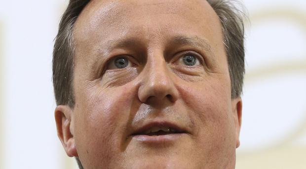 PM David Cameron has urged Afghanistan's two presidential candidates to work towards a democratic unity government in time for next month's Nato summit