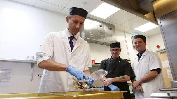 Health Secretary Jeremy Hunt helps prepare food in the kitchen during a visit to the Royal Marsden Hospital in Chelsea