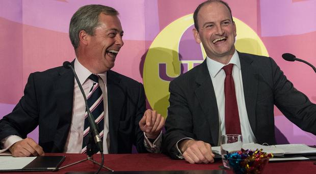 Ukip leader Nigel Farage, left, and Douglas Carswell are visiting Mr Carswell's Clacton by-election battleground