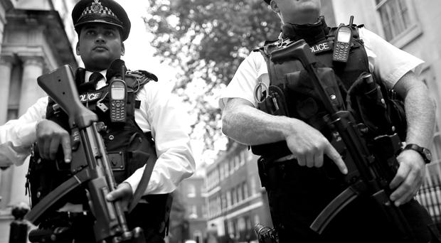 Police officers stand in Downing Street as Home Secretary Theresa May announced that the UK's terror threat level was being raised from substantial to severe