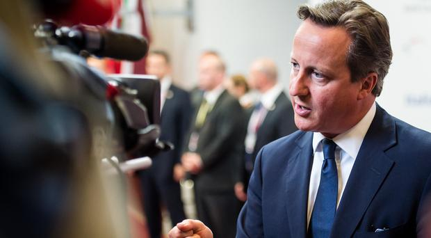 David Cameron insisted there must be 'consequences' if an estimated 1,000 Russian troops are not withdrawn from eastern Ukraine (AP)
