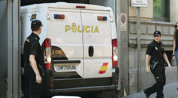 A police van brings the parents of Ashya King to court in Madrid yesterday