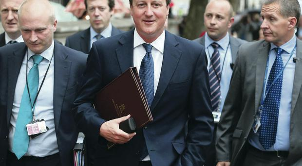 David Cameron walks to Parliament from Downing Street yesterday