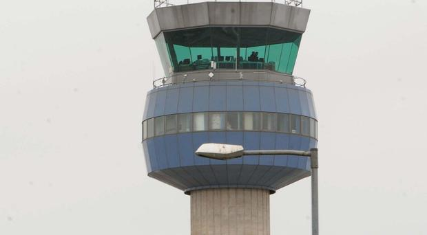 A plane had to be evacuated after landing safely at East Midlands airport