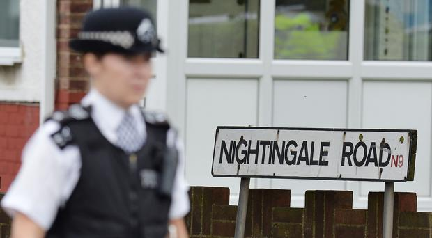 Police on Nightingale Road, Edmonton where a woman was beheaded in a back garden