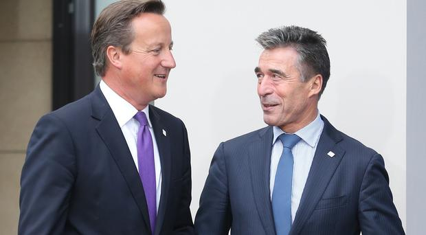 NATO Secretary General Anders Fogh Rasmussen with British Prime Minister David Cameron at the start of the Nato Summit at the Celtic Manor Resort in Newport.