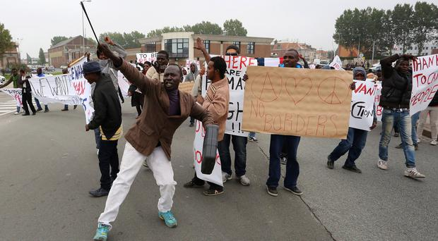 Migrants protesting in Calais, demanding human rights protection