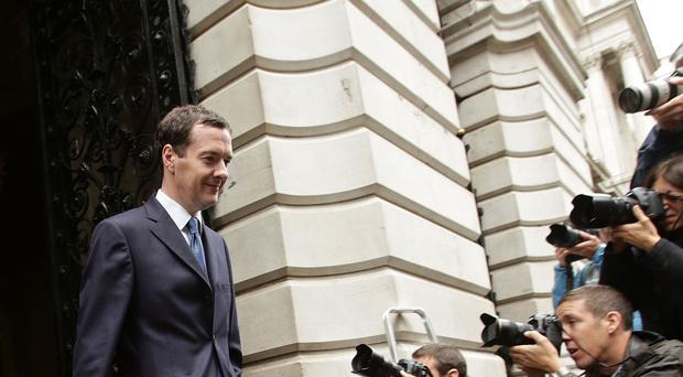 George Osborne said the move would save season ticket holders around £75 over 2014 and 2015