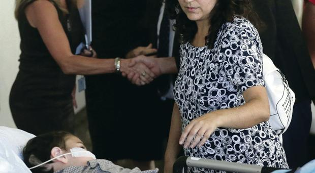 Naghmeh King accompanies her son Ashya as he arrives at the Motol hospital in Prague