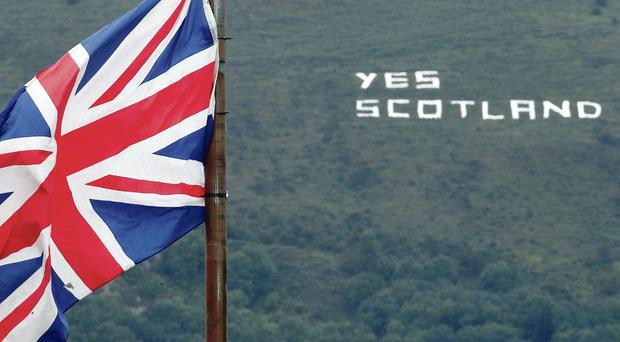 A message on a hill in west Belfast spells out its support for the Yes campaign in Scotland