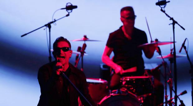 U2 members Bono and Larry Mullen Jr perform during an announcement of new products by Apple (AP)