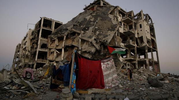 A makeshift tent stands amid the destruction of buildings in a residential neighbourhood in the northern Gaza Strip (AP)