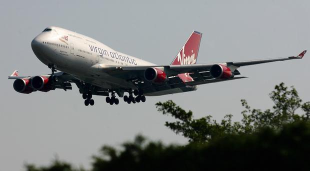 A Virgin Atlantic Boeing 747 hit such severe turbulence that passengers and a crew member were injured, a report has said