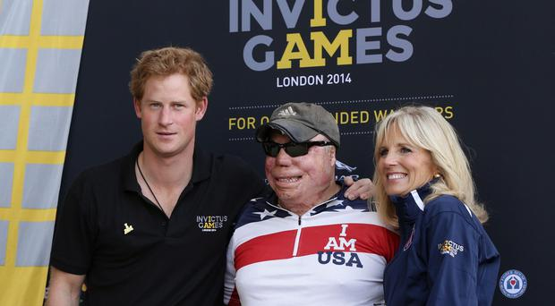 Prince Harry with Israel Del Toro Jrn, a US Air Force Tech Sgt who was injured in Afghanistan in 2005 and Jill Biden